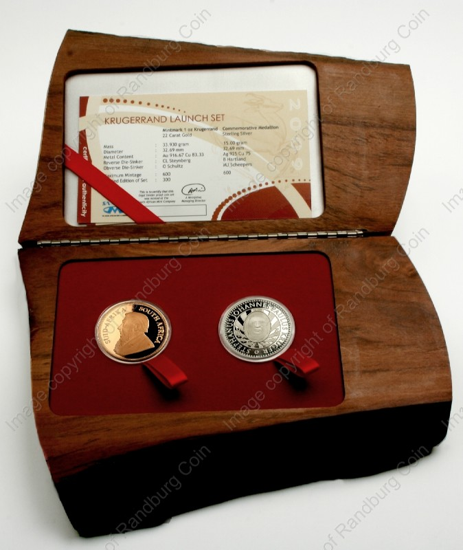 2009_Gold_KR_1_oz_Launch_Mintmark_Set_with_Silver_Com_Medallion_Box_open_ob