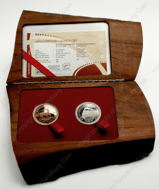 SA_Gold_KR_Proof_4_BOB_WM/2009_Gold_KR_1_oz_Launch_Mintmark_Set_with_Silver_Com_Medallion_Box_open_rev