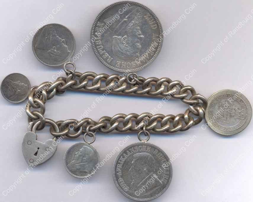 Silver_Bracelet_with_ZAR_Coins_and Medallion_ob.jpg