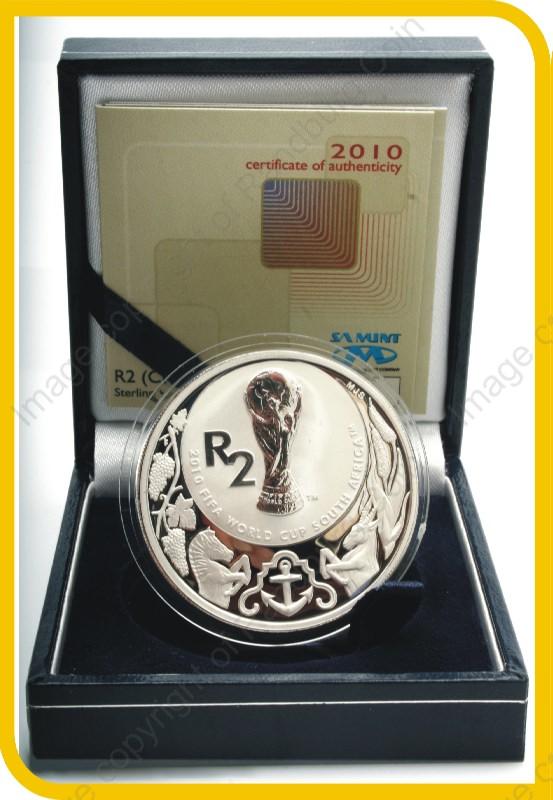 2010_Silver_R2_proof_FIFA_Crown_coin_open_box_rev